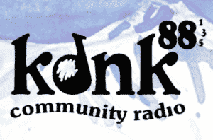 KDNK Radio Logo and a former client of STU Enterprises